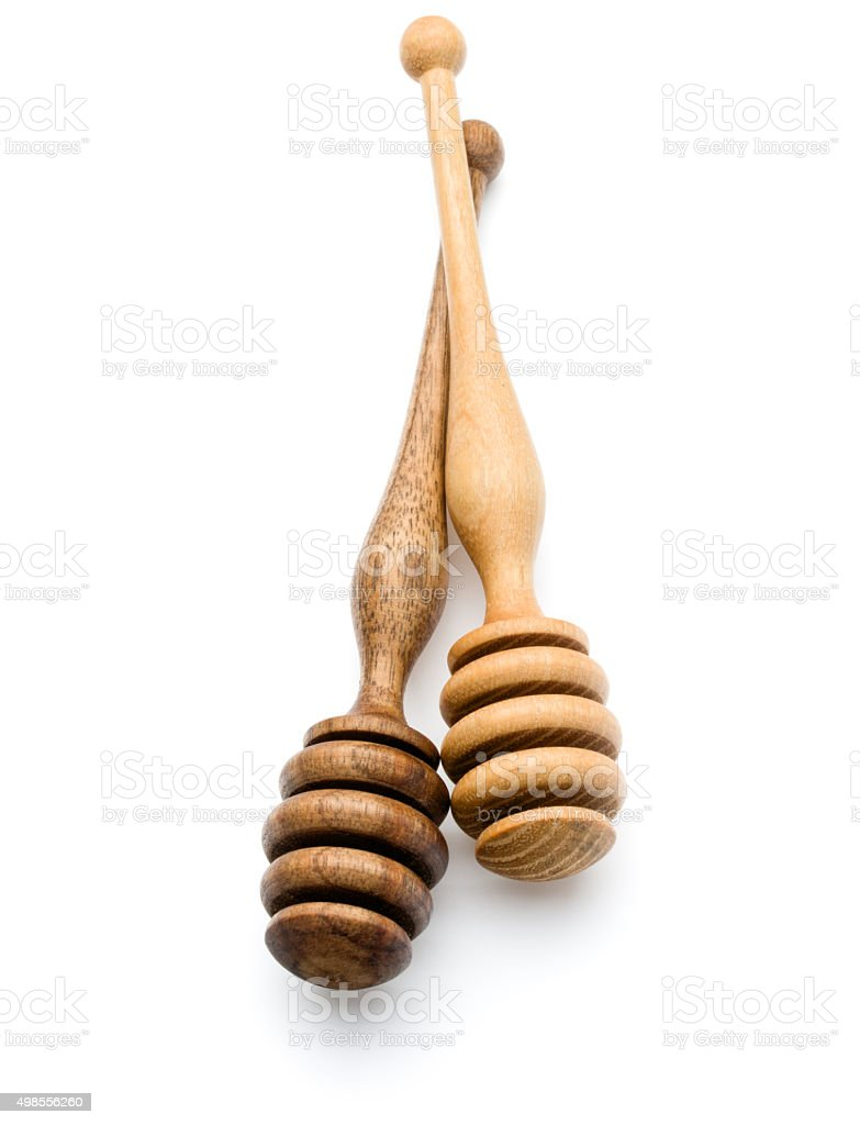 Carving wooden honey dipper spoon isolated on white background c stock photo