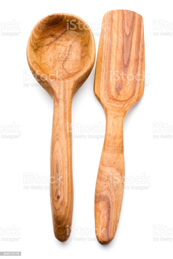 Carving wooden spoon isolated on white background cutout stock photo