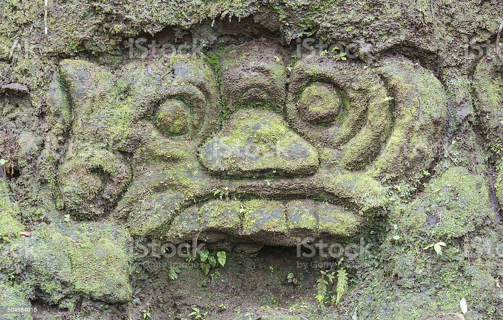 Carvings at Goa Gajah temple in Bali stock photo