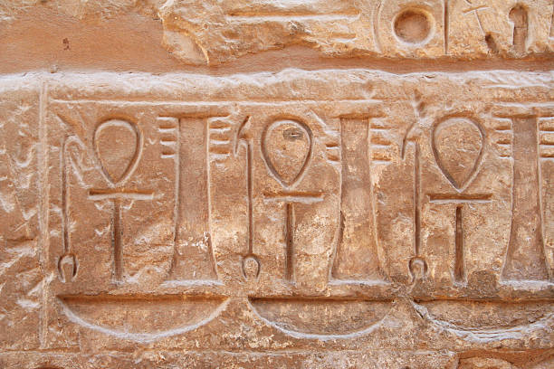Carvings of ankhs on the wall stock photo