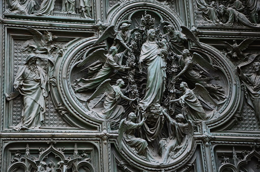 Carvings on Duomo cathedral in Milan in Italy