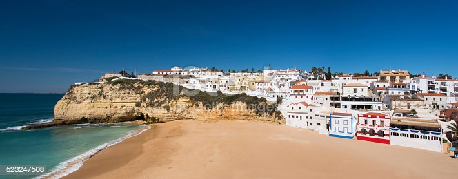 Panoramic view of the village and beach of Carvoeiro on the rocky coastline of the Algarve, Portugal.
