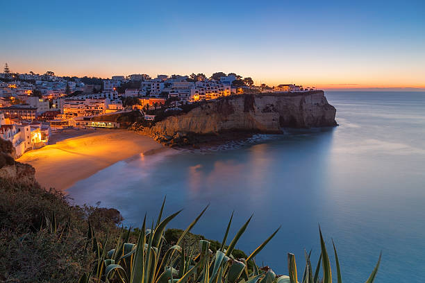 Carvoeiro village while climbing of the sun, sunrise. Portugal. stock photo