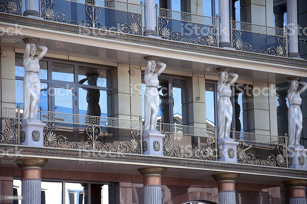 Caryatids on the facade of a modern building stock photo