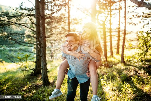 Young couple having fun in the woods