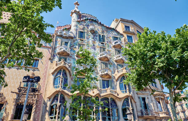 Casa Batllo  is a renowned building located in the center of Barcelona BARCELONA, SPAIN -MAY 19, 2018:  Casa Batllo  is a renowned building located in  Barcelona and is one of Antoni Gaudi's masterpieces. passeig de gracia stock pictures, royalty-free photos & images