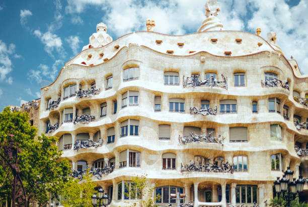 Casa Mila also known as La Pedrera Barcelona, Spain - June 26, 2017: Front view of Casa Mila designed by Antonio Gaudi located on Passeig De Gracia. passeig de gracia stock pictures, royalty-free photos & images