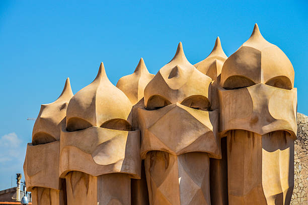 Casa Mila in Barcelona, Spain Barcelona, Spain - August 20, 2015: Roof top picture from Casa Mila taken during the day.  casa batllo stock pictures, royalty-free photos & images