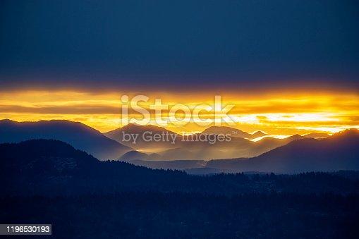 Foggy sunrise over Cascade Mountain Range, WA