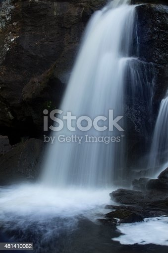 Chapman Falls in long exposure, cascading onto rocks at Devil's Hopyard State Park, Connecticut. Vertical image.
