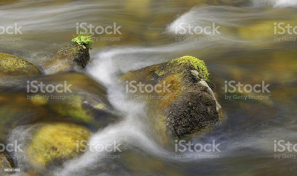 cascading over rocks royalty-free stock photo