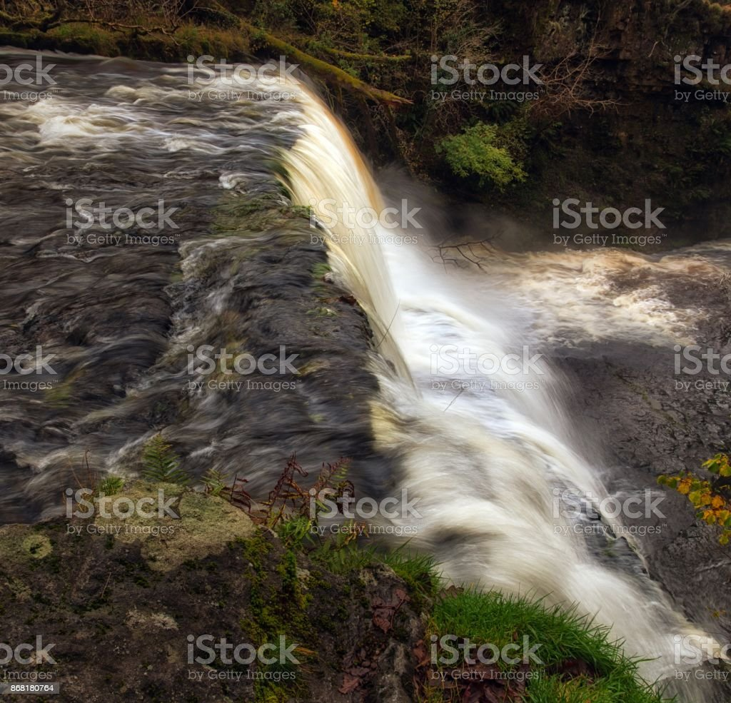 Cascading water at Sgwd Clun Gwyn waterfall stock photo