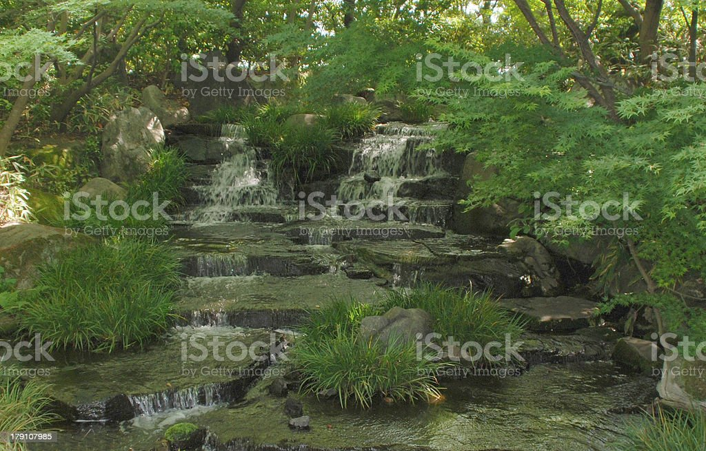 Cascading Water in Japanese Gardens royalty-free stock photo