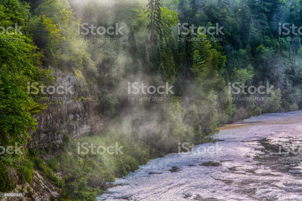 Cascading Water on a Rocky Shore stock photo
