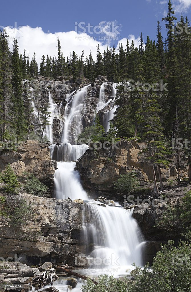 Cascading waterfall in Canadian Rockies stock photo