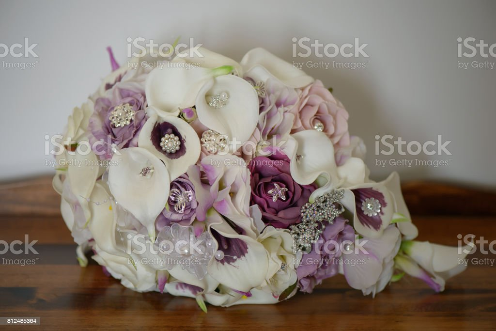 Cascading Wedding Bouquet With Calla Lilies Purple Roses Decorated