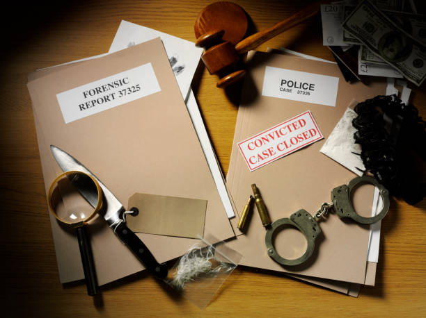 case closed with police files and forensic paperwork - murder mystery stock photos and pictures
