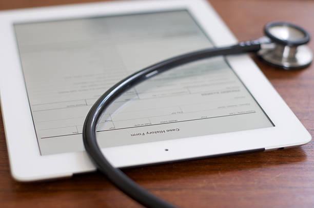 Case history form on iPad 4 stock photo