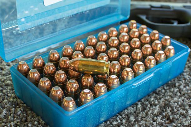 Case of fifty shiny bullets stock photo