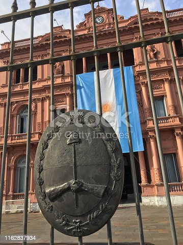 Hanging argentinian flag from the Casa Rosada balcony. It is there for the celebration of the independence day which is the 9th of july