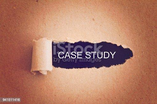 Case study written under torn paper.