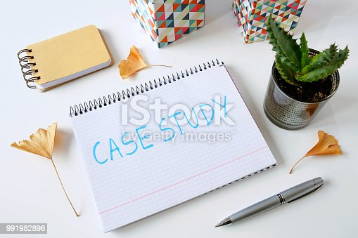case study written in a notebook on white table