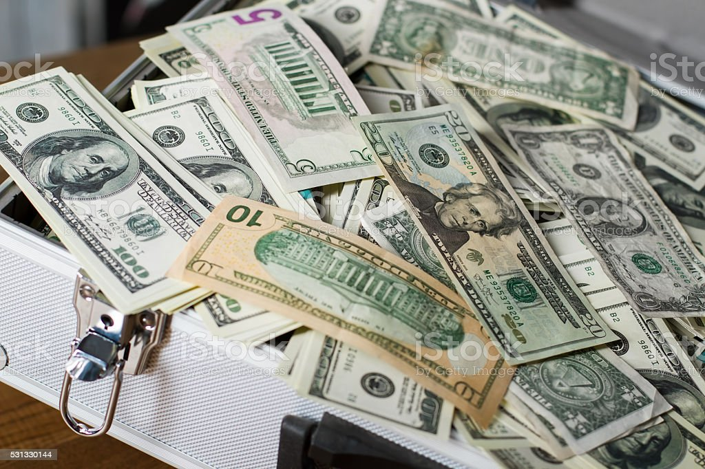 Case with pile of dollars. stock photo