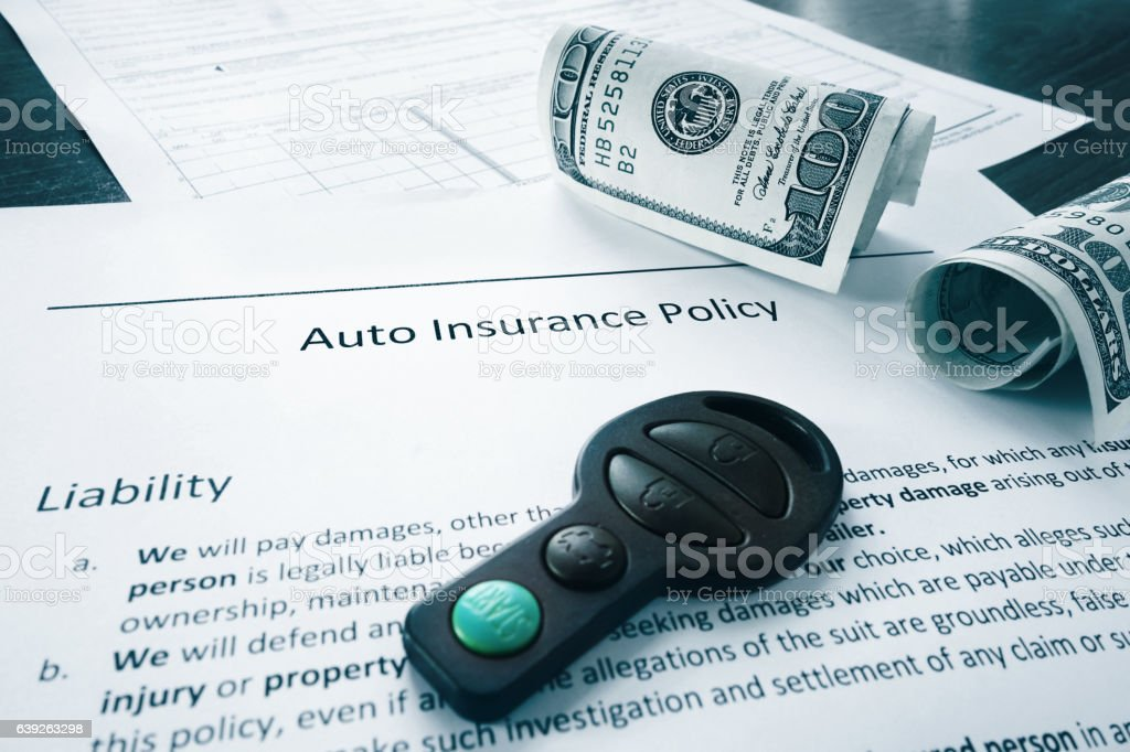 cash and auto insurance policy stock photo