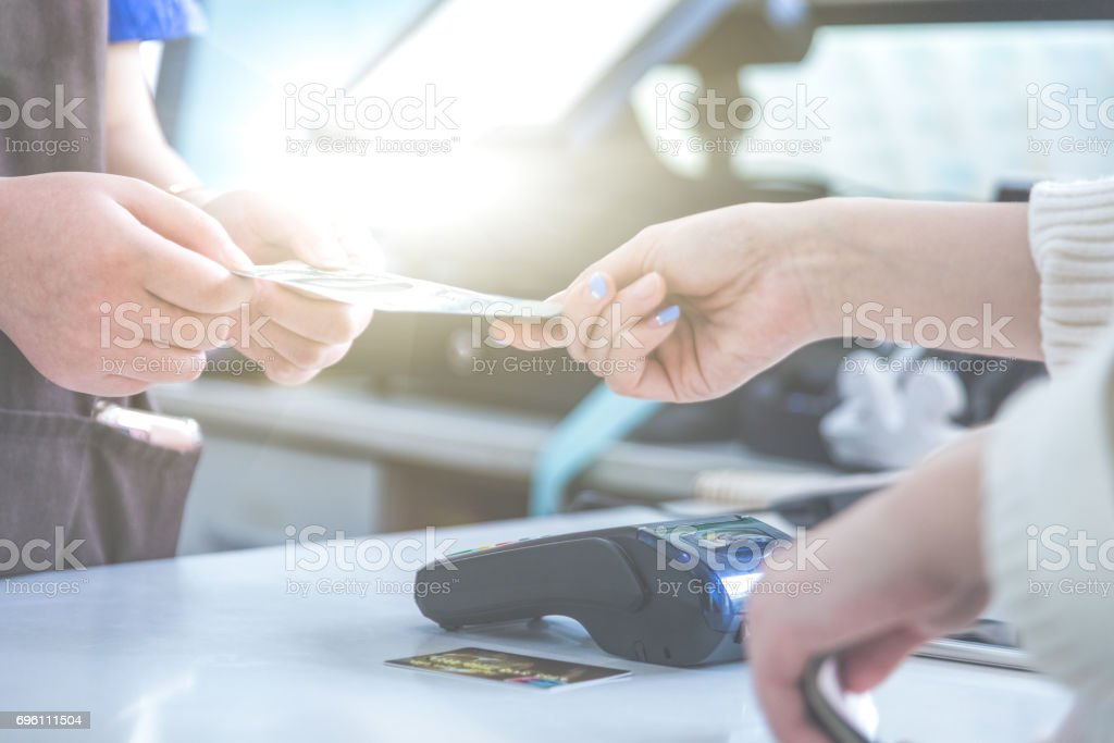 cash and card payment with chip and pin machine in shop stock photo