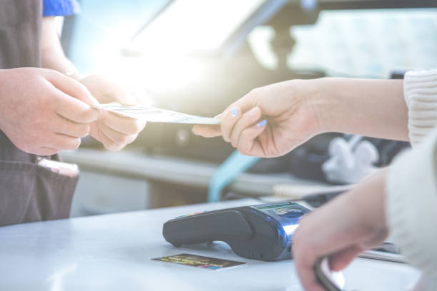 cash and card payment with chip and pin machine in shop - receipt stock photos and pictures