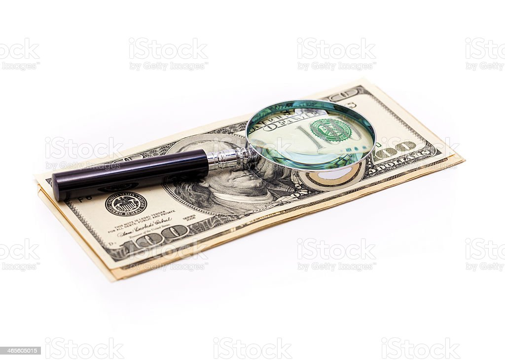 Cash and magnifying glass royalty-free stock photo