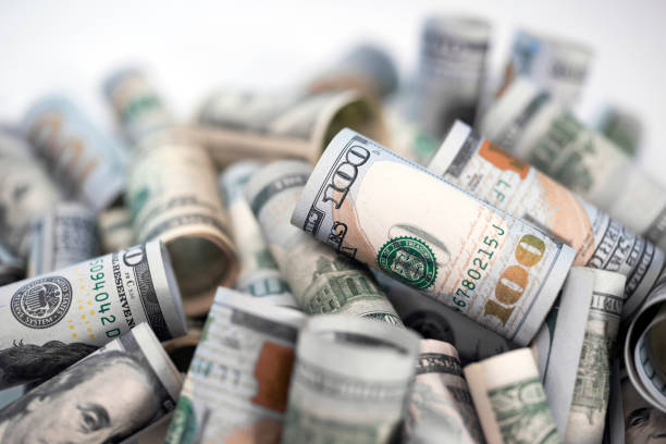 cash bills as symbol of financial stability - dollar bill stock pictures, royalty-free photos & images