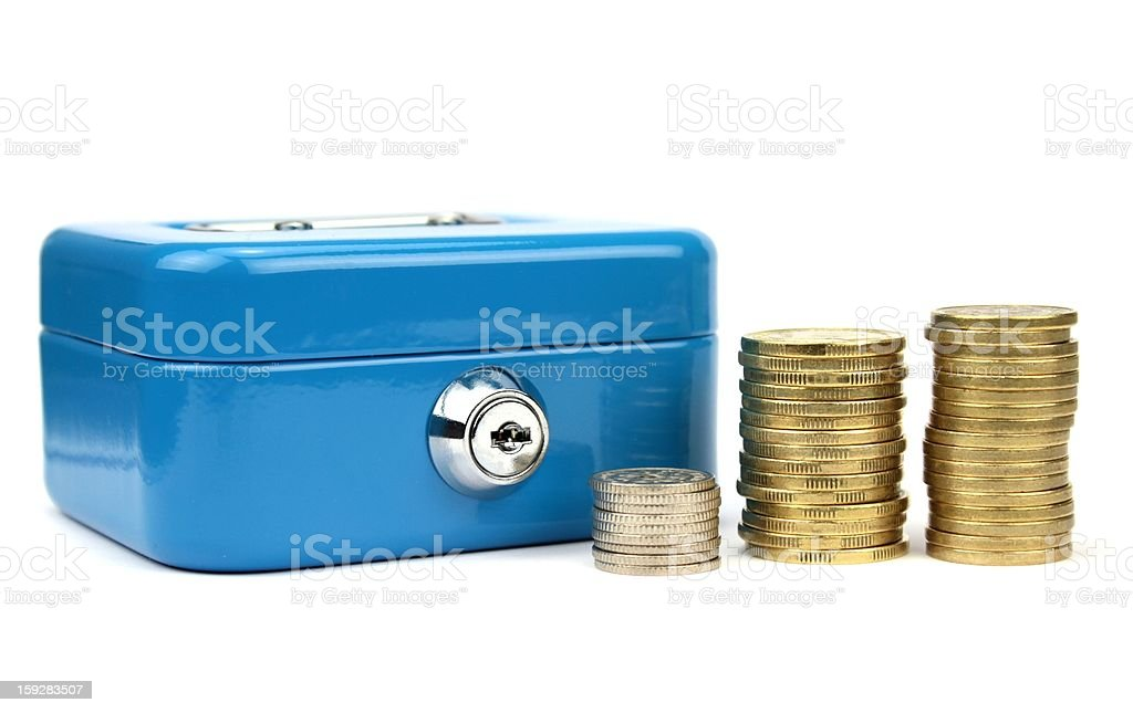 Cash box with lock  and stacked coins royalty-free stock photo