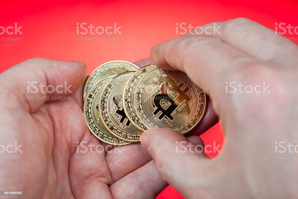 Cash coin internet currency Bitcoin lies in  human palm, closeup. stock photo
