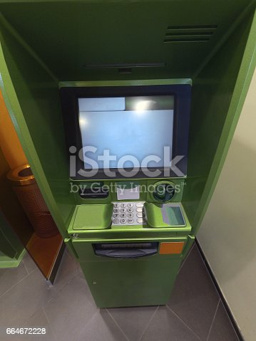 istock Cash dispenser for green money appearance from the top 664672228