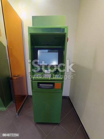 istock Cash dispenser green is ready for work 664672234