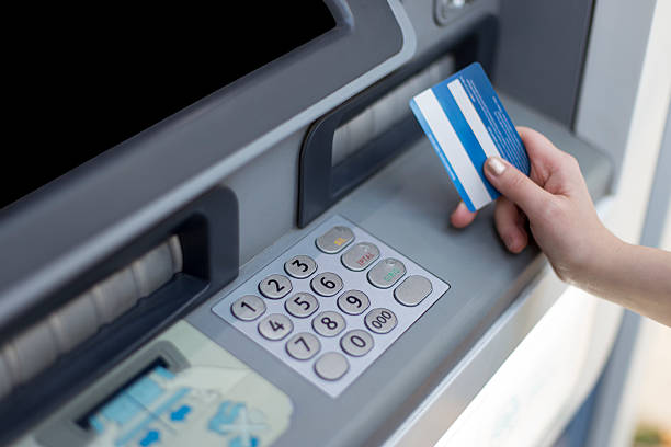 Cash dispenser Cash dispenser animal hand stock pictures, royalty-free photos & images