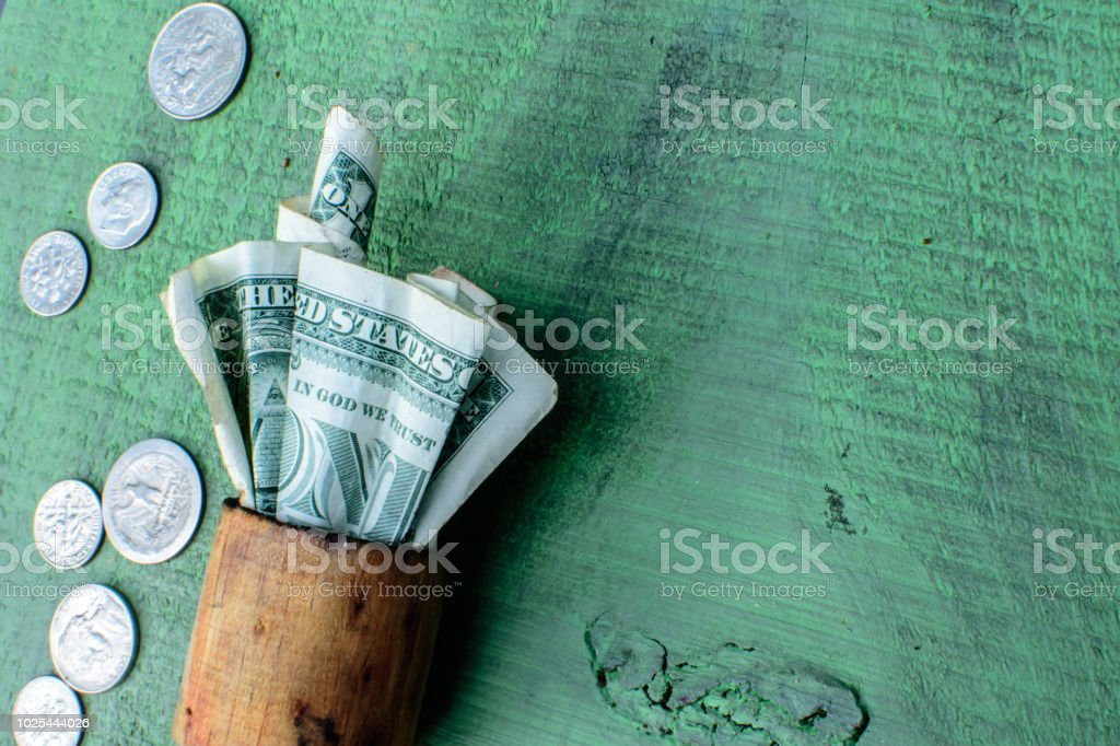 Cash Flat lay on rustic wood with copy space Money and spare change US dollars stock photo