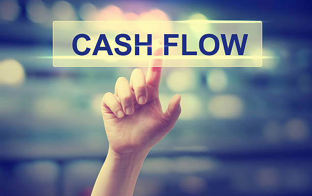 Cash Flow concept with hand pressing a button Cash Flow concept with hand pressing a button on blurred abstract background cash flow stock pictures, royalty-free photos & images