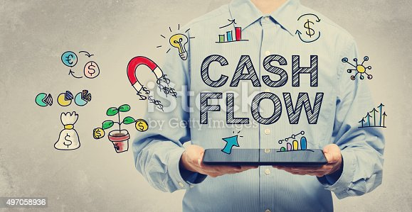 istock Cash Flow concept with young man holding a tablet 497058936
