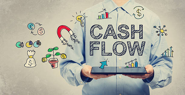 Cash Flow concept with young man holding a tablet Cash Flow concept with young man holding a tablet computer cash flow stock pictures, royalty-free photos & images