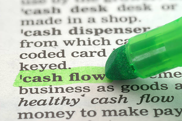 cash flow definition highlighted in dictionary  cash flow stock pictures, royalty-free photos & images