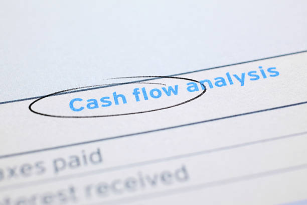 "Cash Flow ""Close-up on the financial document title - Cash Flow, circled by pen."" cash flow stock pictures, royalty-free photos & images"