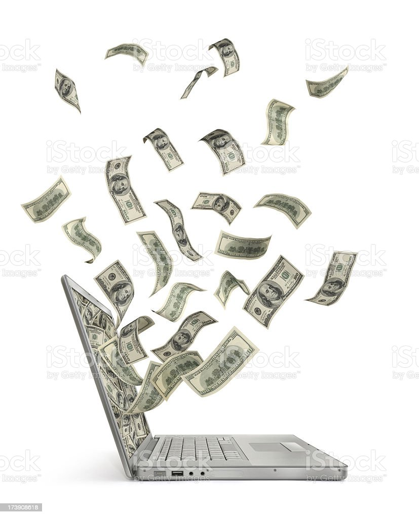 Cash Flow With Computer Cash (one hundred-dollar bills) flowing in and out of a portable computer (laptop) screen. Isolated on white background. Abundance Stock Photo