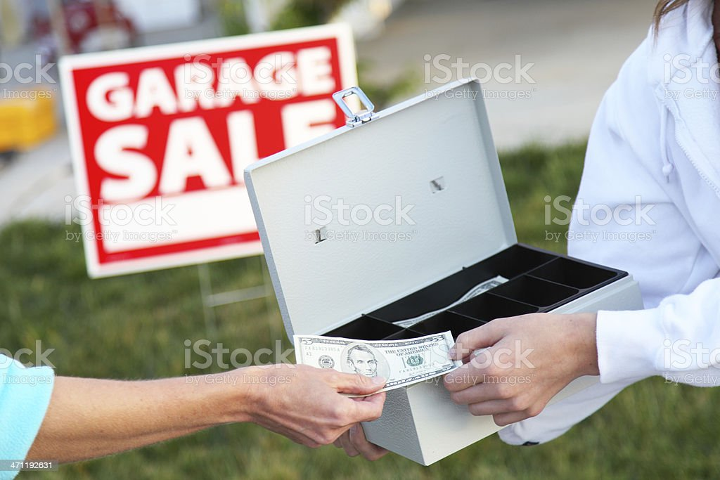 Customer making purchase at a Garage Sale.