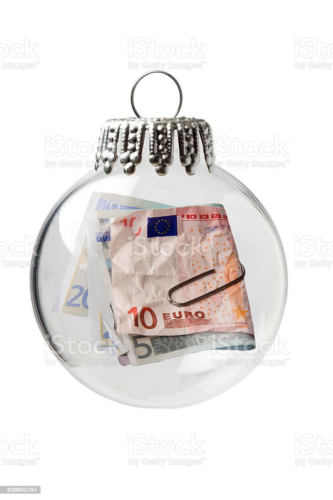 Cash in a Christmas Ornament stock photo