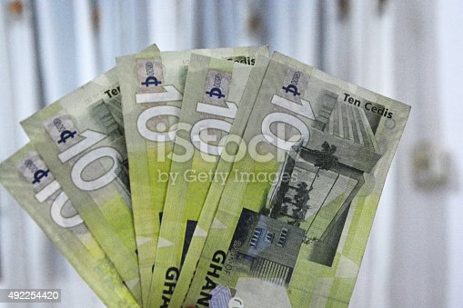 Ghana ten ghc notes spreaded in hand