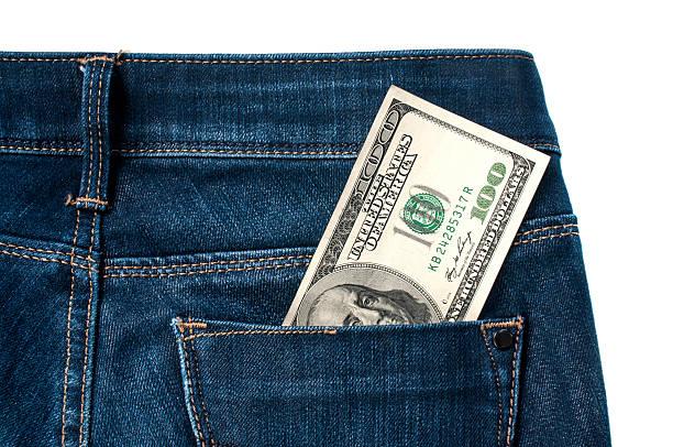 Dinheiro em jeans - foto de acervo