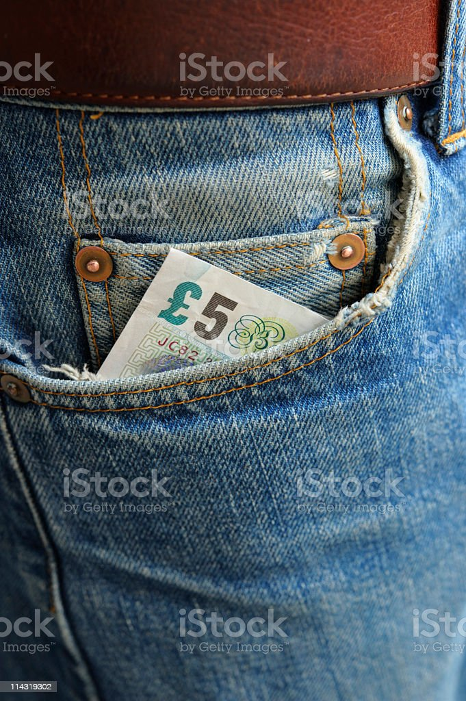 Cash in Worn Denim Jeans Pocket series - five pounds royalty-free stock photo