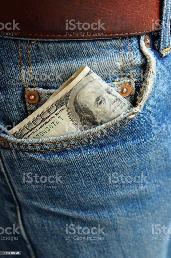 Cash in Worn Denim Jeans Pocket series - hundred dollars royalty-free stock photo